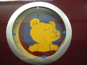 photo of shower-room porthole graphic